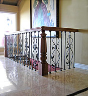 Cherry with Iron Scroll Staircase